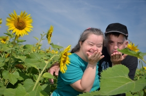 Couple with Down Syndrome in Sunflower Field