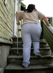 Woman with Cane Walking up Stairs