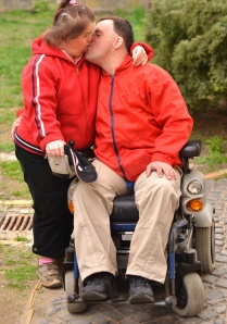 Couple with Down Syndrome Kissing