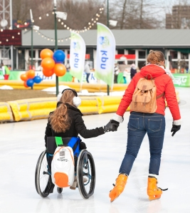 Two Women, One in Wheelchair, Ice Skating